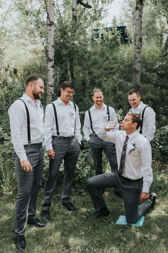 groom drinking on one knee after being iced
