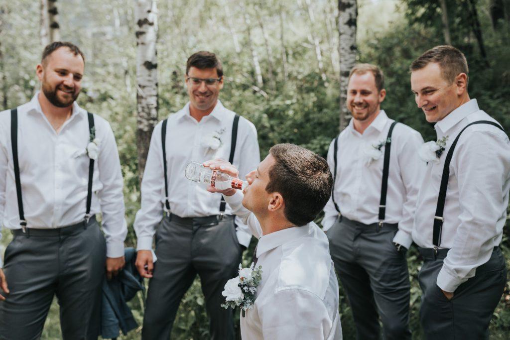 groom drinks smirnoff ice