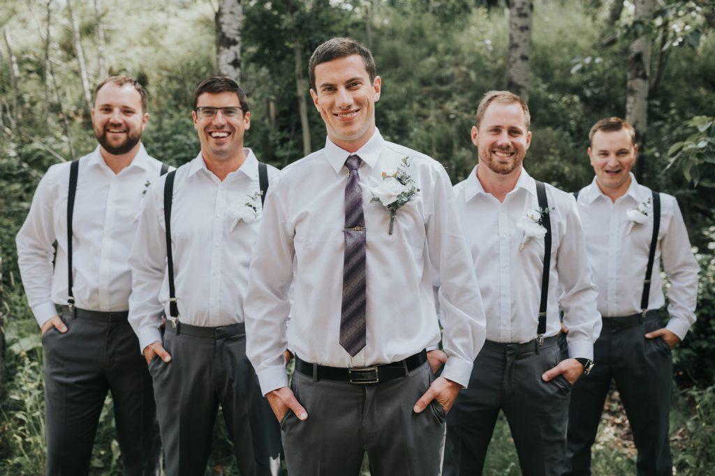 groom smiling with groomsmen