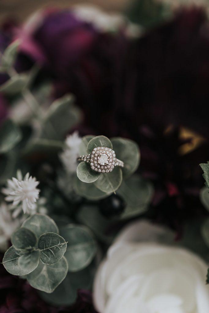brides ring on wedding bouquet photo