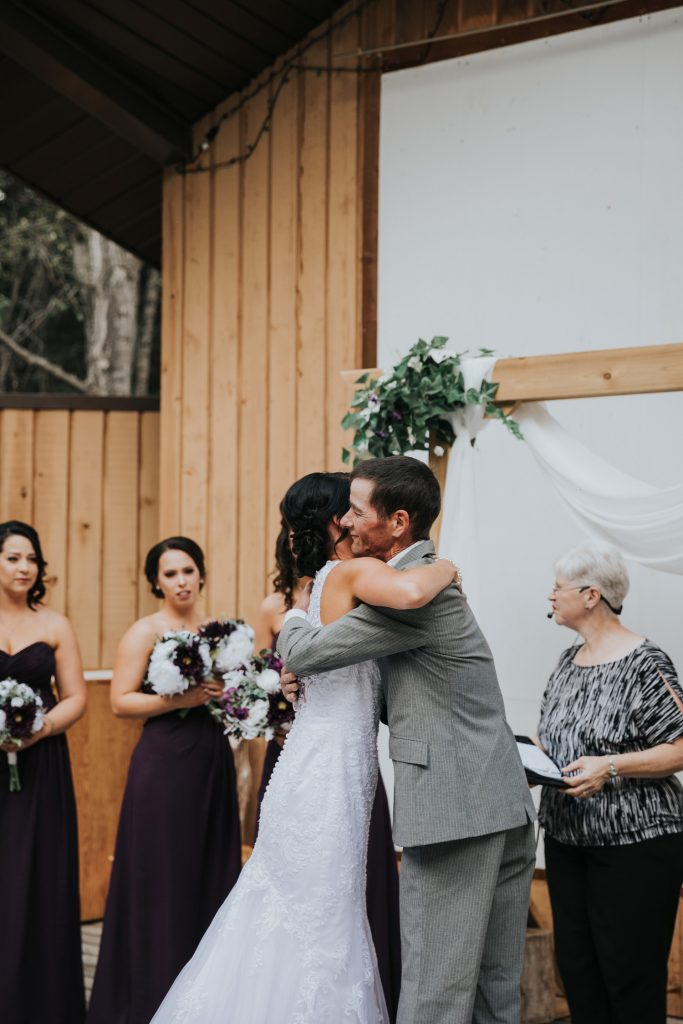 bride hugs her dad at altar elkwater wedding
