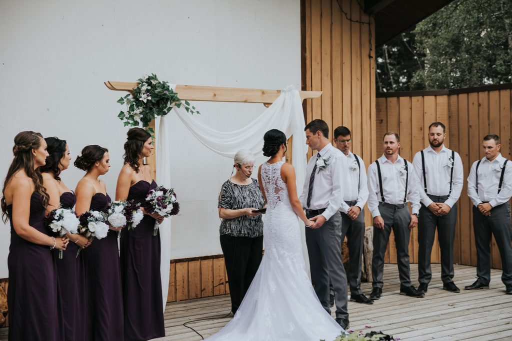 wedding party standing during ceremony elkwater amphitheatre