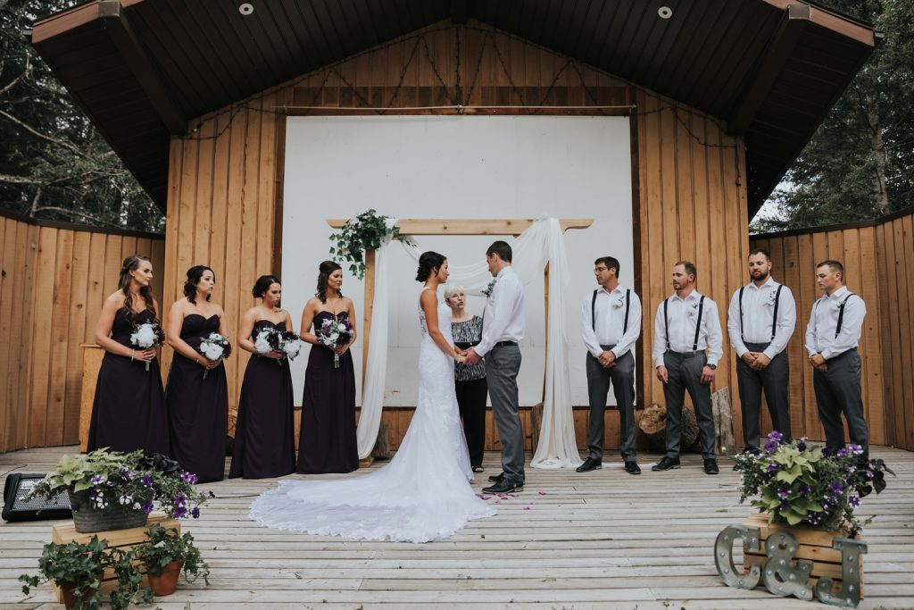 wedding party during ceremony elkwater amphitheatre