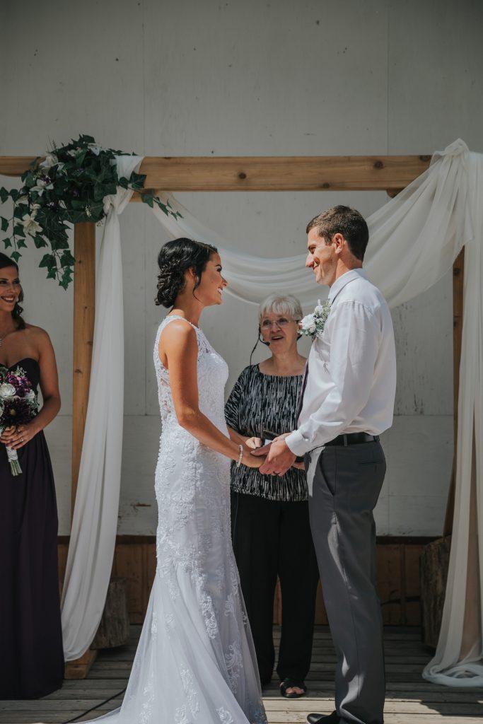 bride and groom smile wedding ceremony elkwater amphitheatre