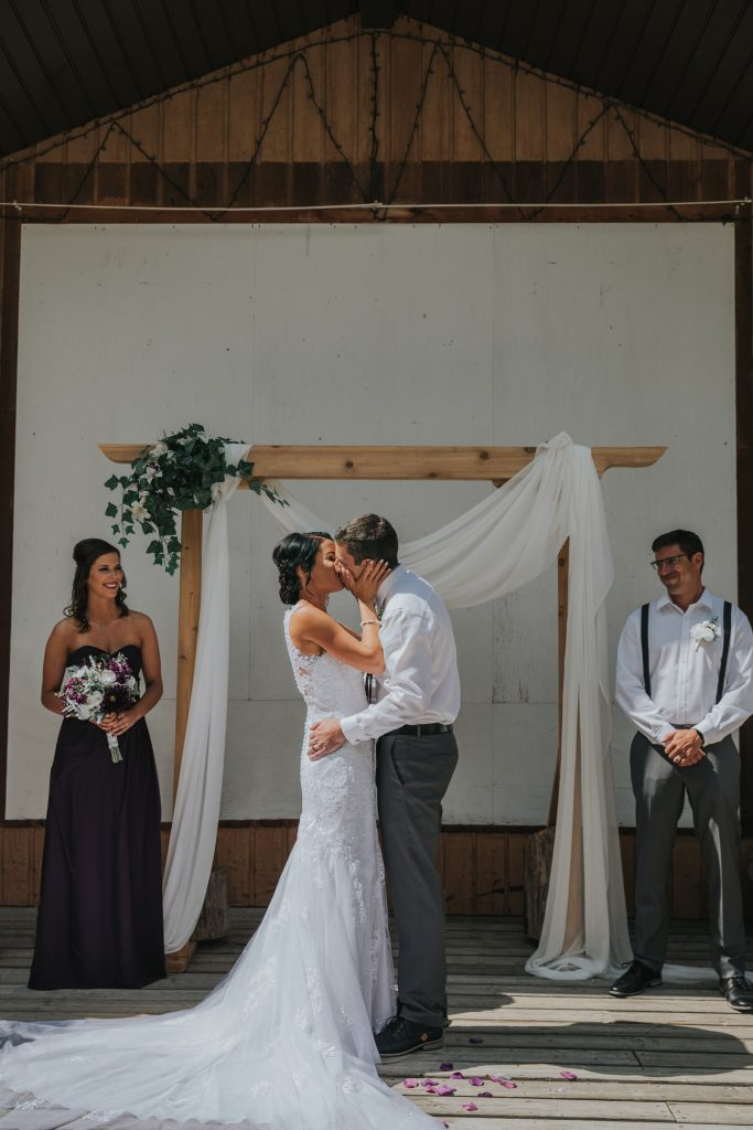 bride and groom first kiss wedding ceremony cypress hills