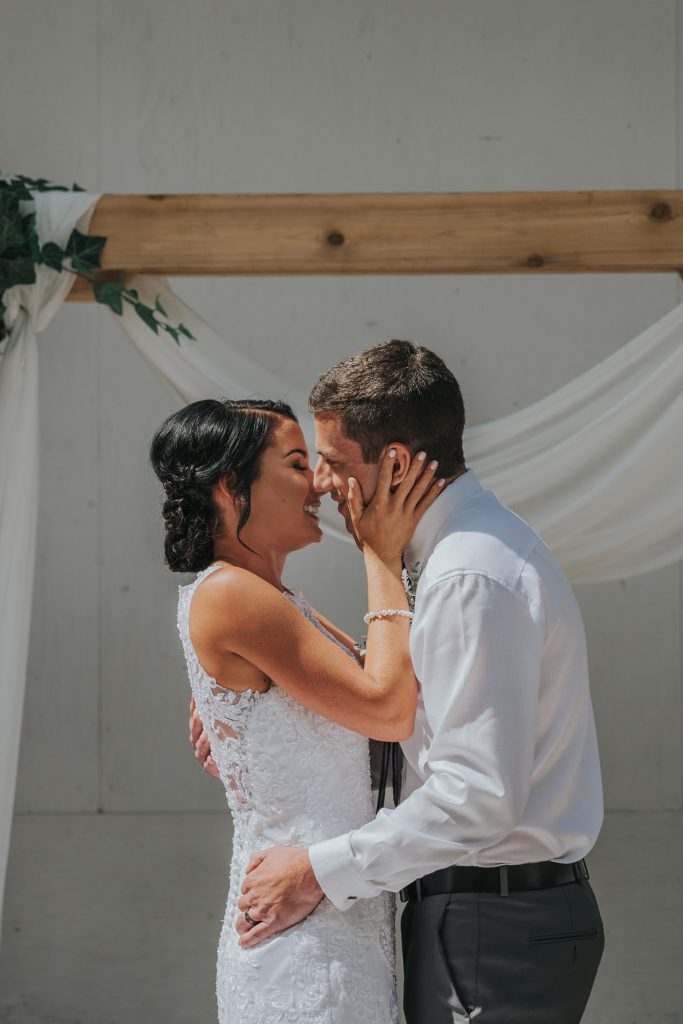 bride and groom smile after first kiss elkwater amphitheatre