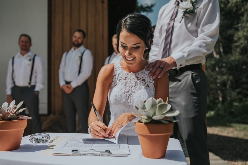 bride signs marriage certificate
