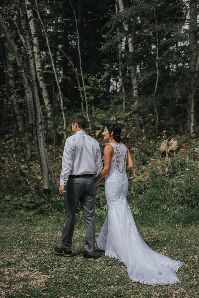 bride and groom walking away after ceremony elkwater