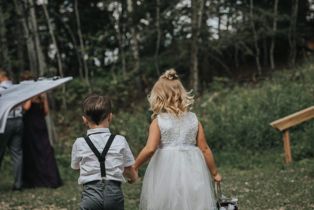 flower girl and ring bearer holding hands