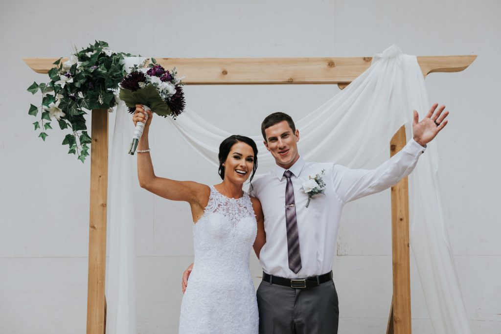 bride and groom cheering at altar elkwater amphitheatre