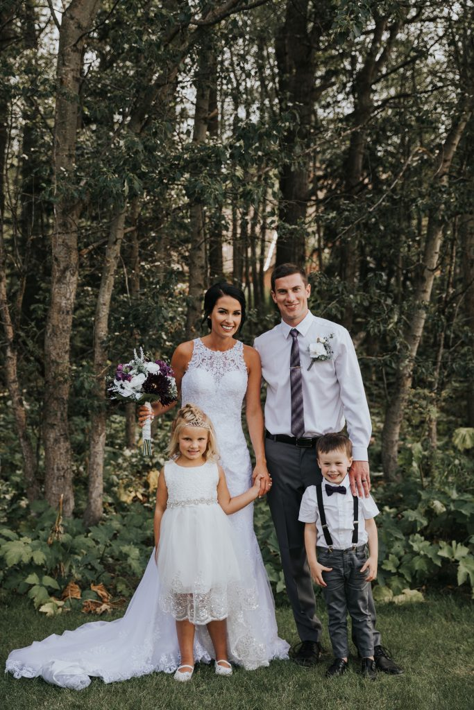 bride and groom pose with flower girl and ring bearer elkwater wedding