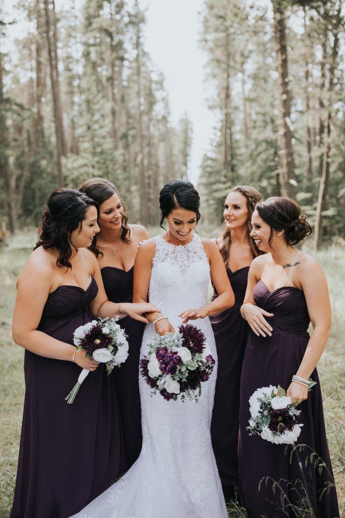 bridesmaids gather around bride admiring wedding rings