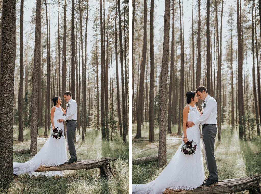 bride and room standing close on tree log forest elkwater