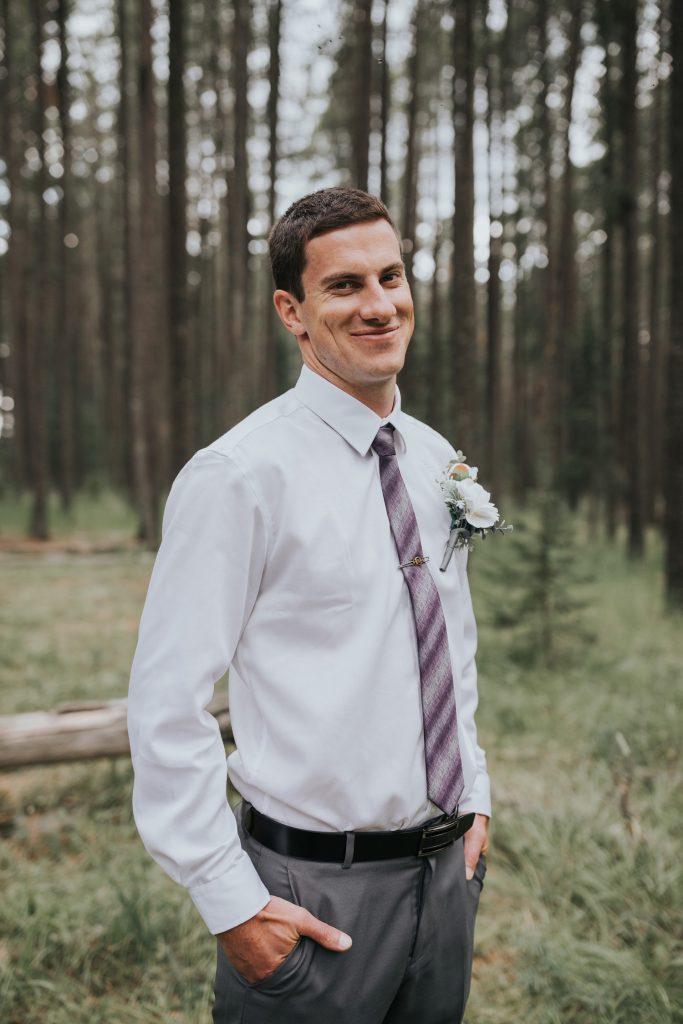 portrait of groom smiling elkwater