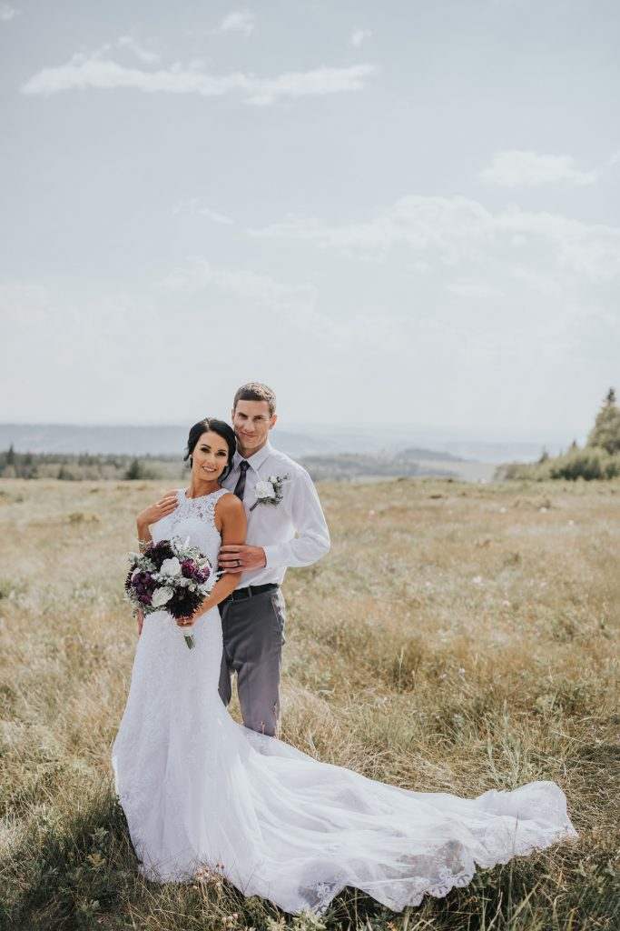 bride and groom at head of the mountain wedding photo