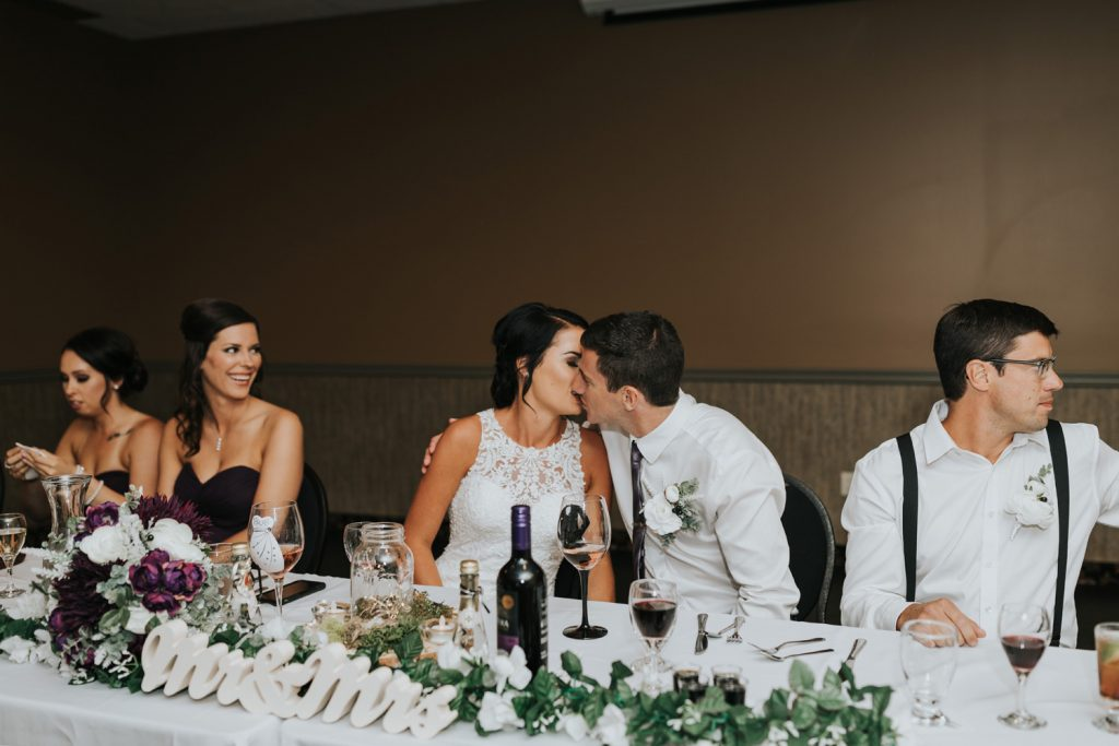 bride and groom kiss during reception