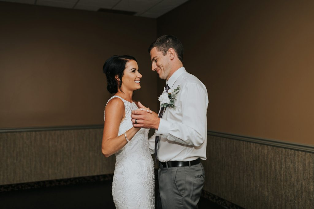 bride and groom laughing during first dance wedding reception elkwater alberta