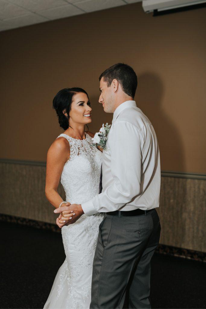 bride smiles at groom elkwater lake lodge wedding dance