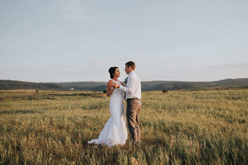 wedding couple dancing together near Elkwater Alberta