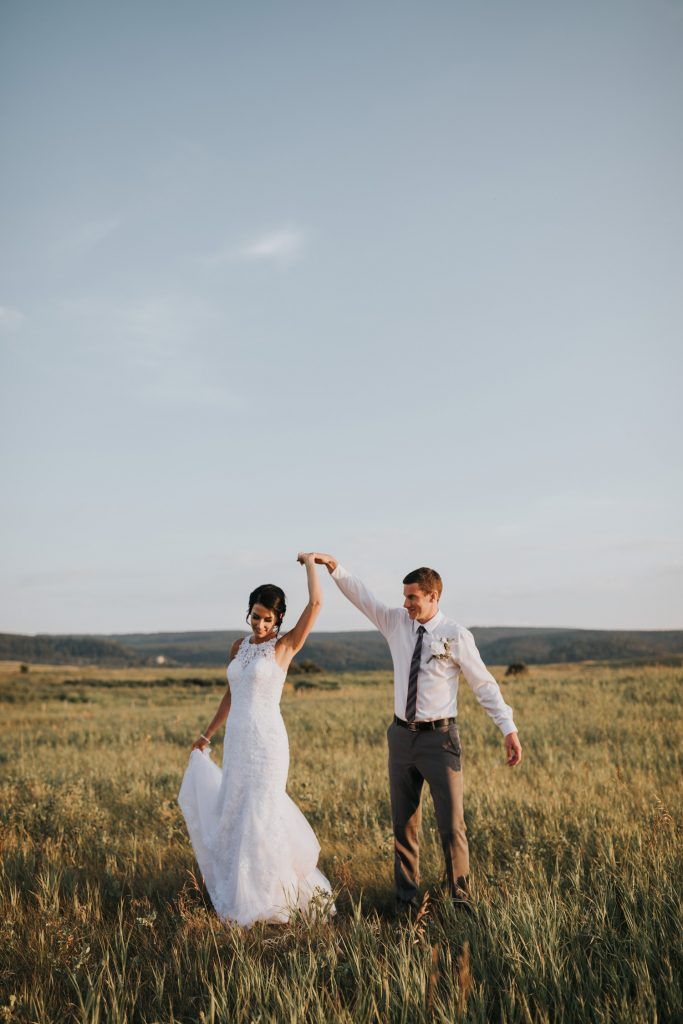 bride and groom couple dancing at sunset