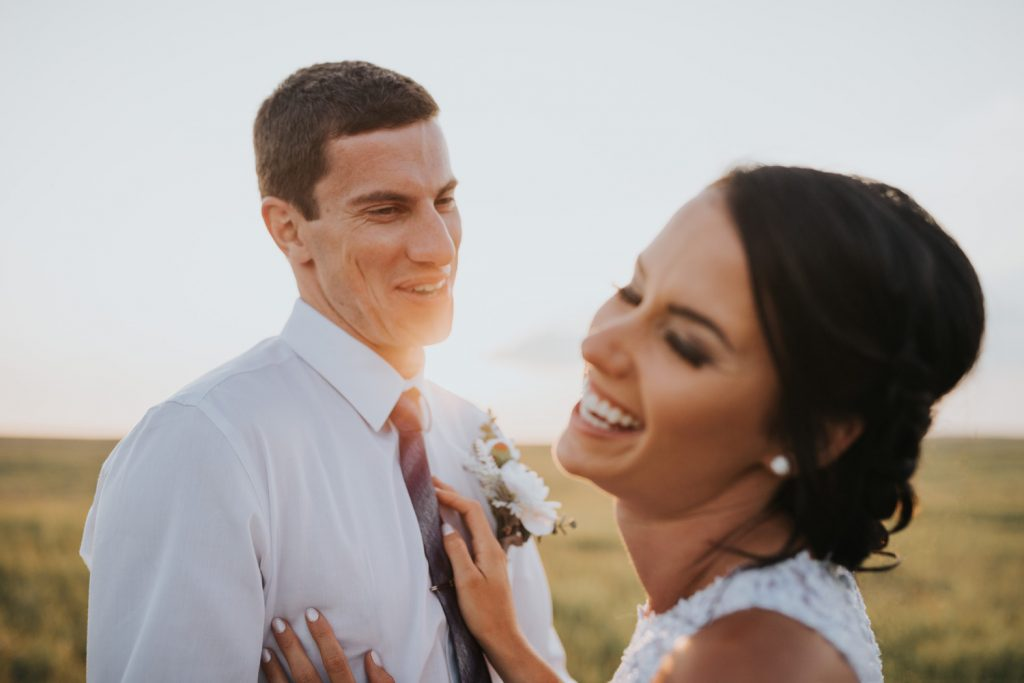 bride and groom laughing during wedding photos