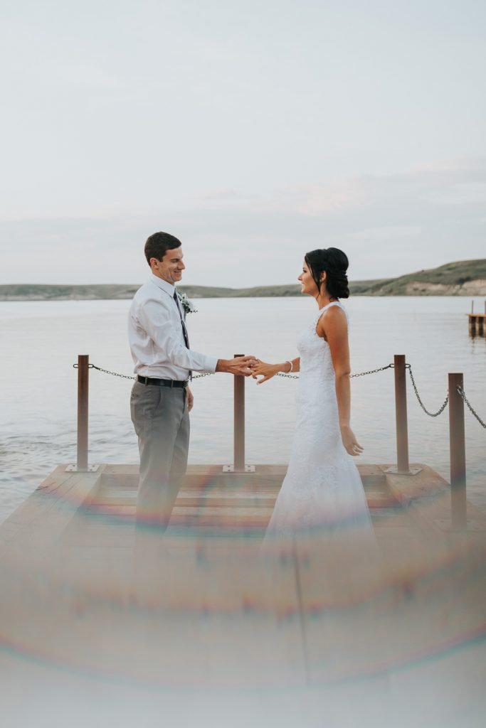 married couple dances on dock