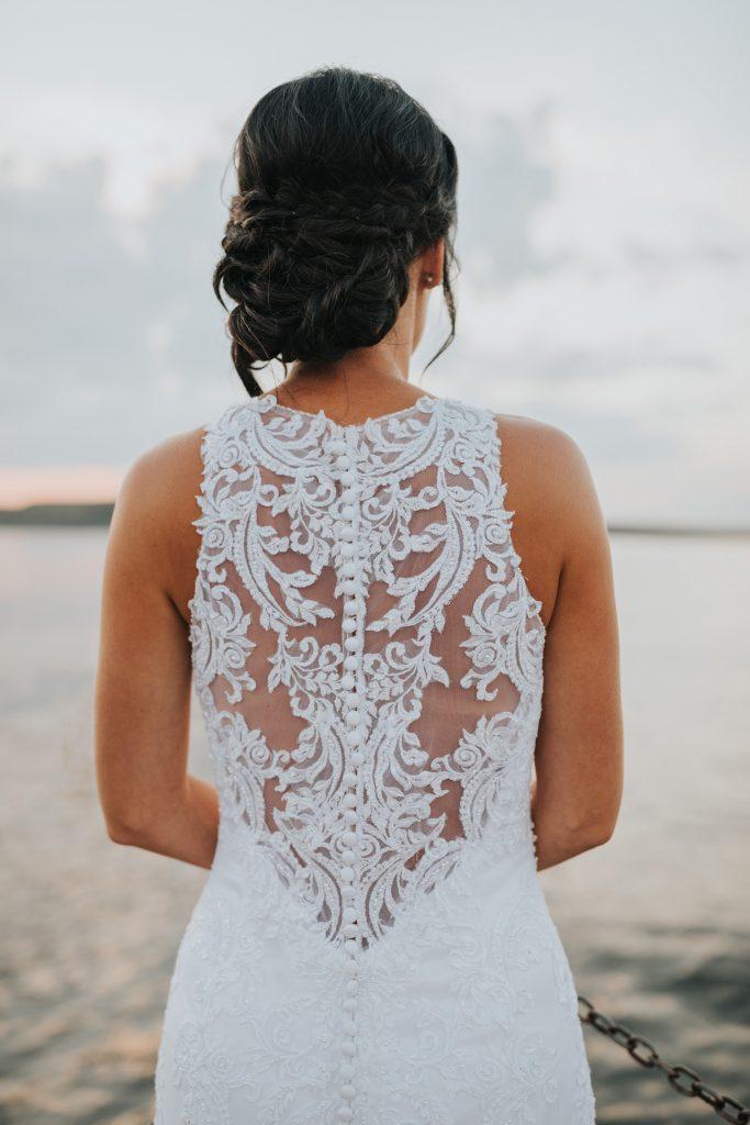 detail photo of bride's wedding dress lace