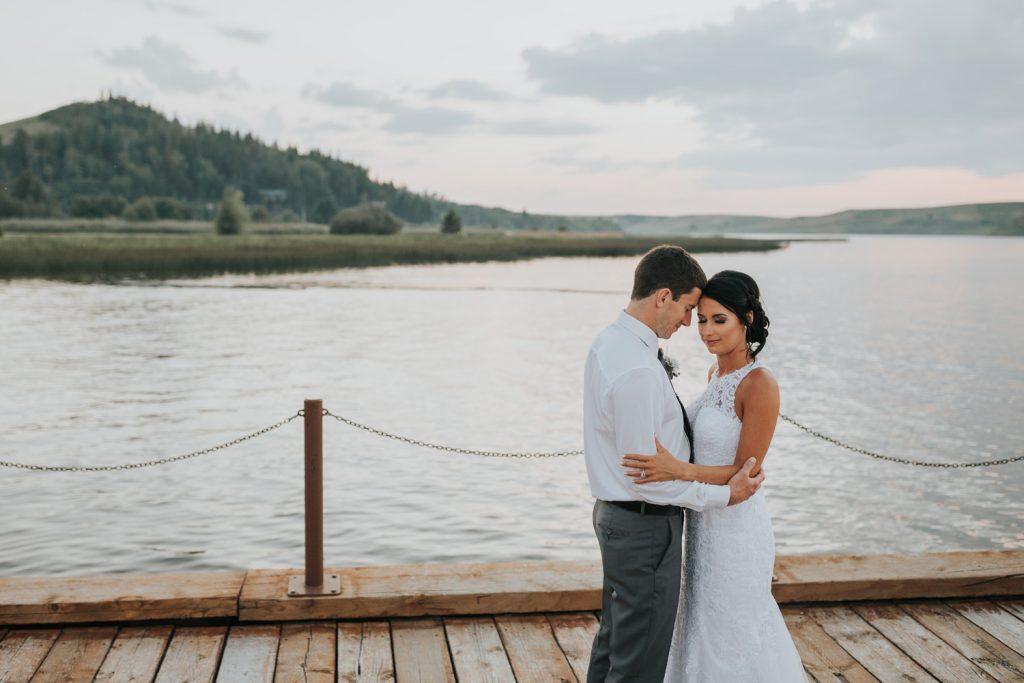 wedding photo couple embracing on dock