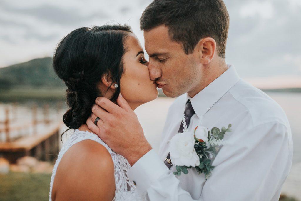 sunset wedding portrait couple kissing