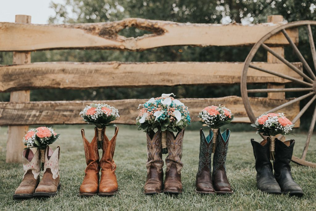 bridal party cowboy boots with bouquets
