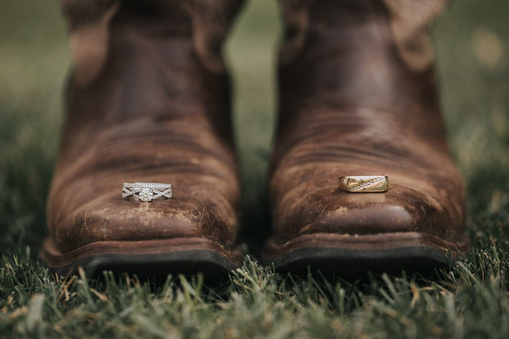 brides cowboy boots with wedding rings