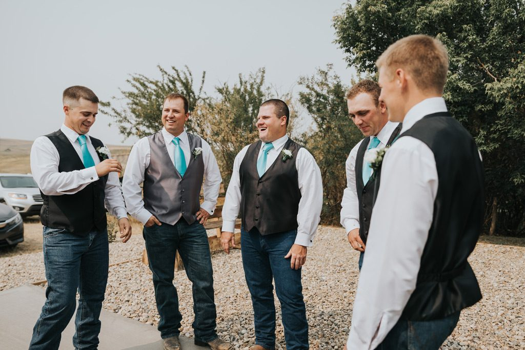 groomsmen laughing waiting for wedding ceremony