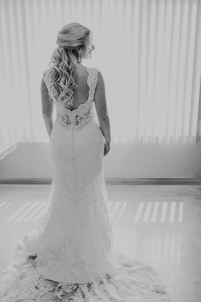 bride stands with her dress on