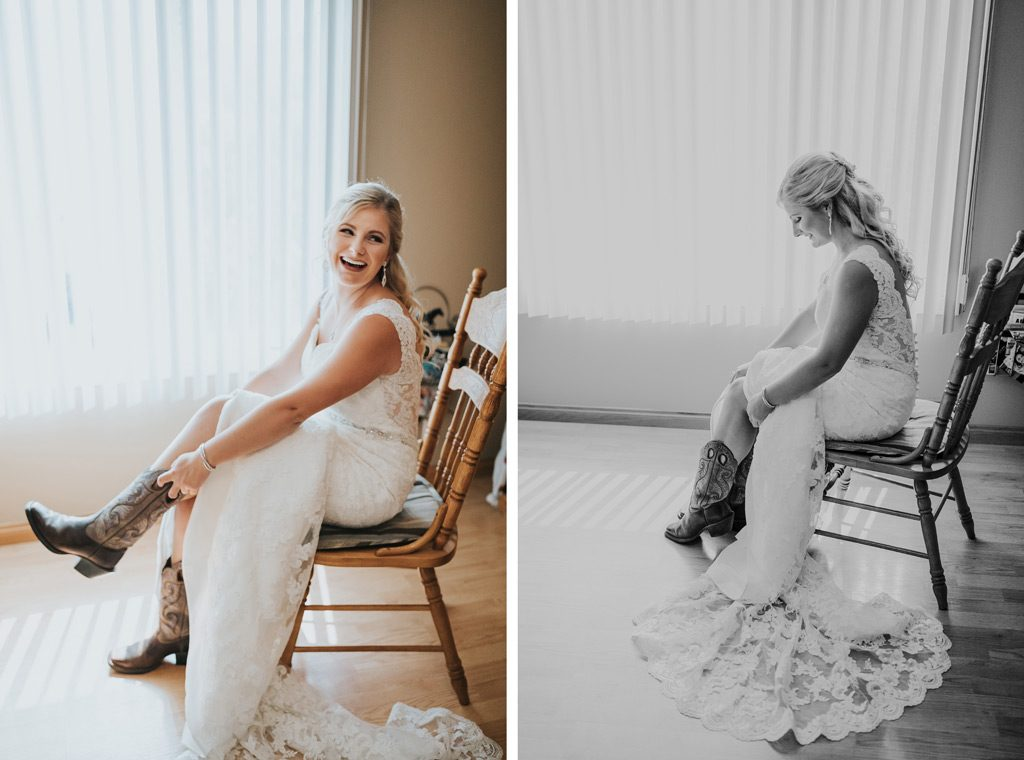 bride smiles as she puts her cowboy boots on