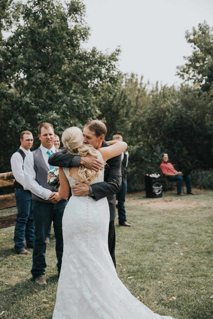 bride hugs her dad after walking down the aisle