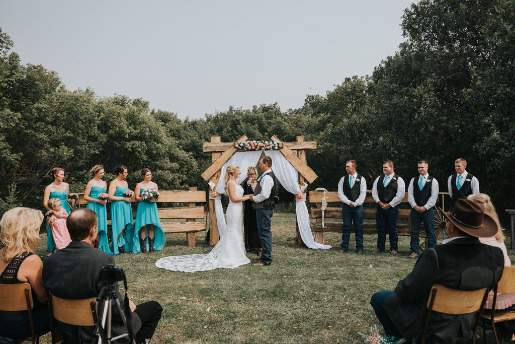 bridal party stands during wedding ceremony