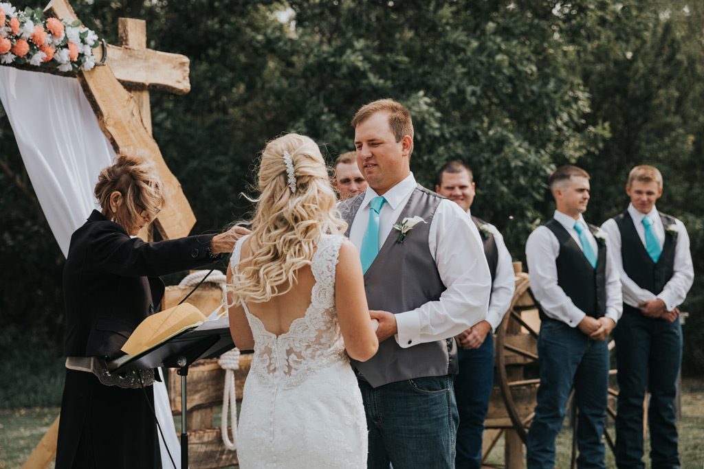 bride says her vows during wedding ceremony