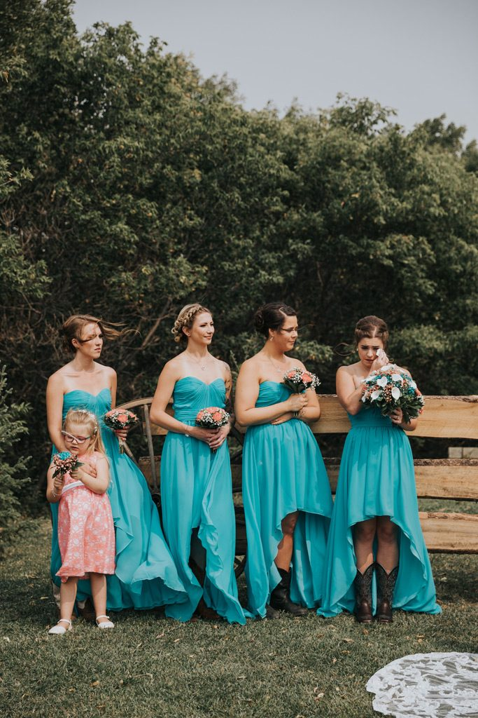 bridesmaids tearing up during wedding ceremony