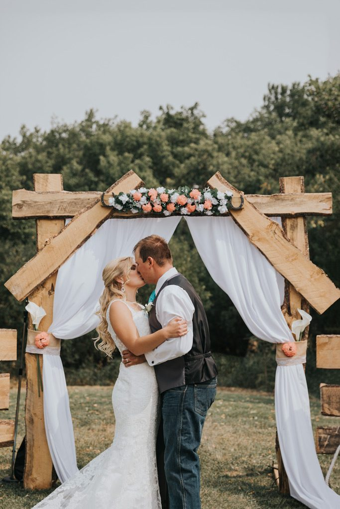 couples first kiss wedding ceremony alberta family farm