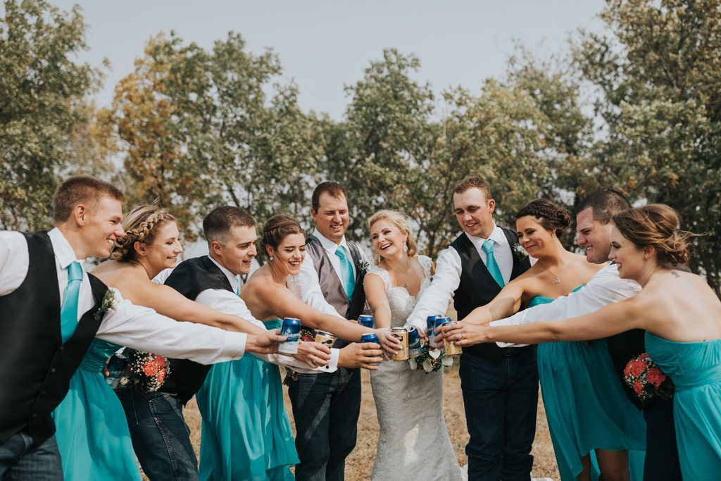 bridal party cheers beer cans