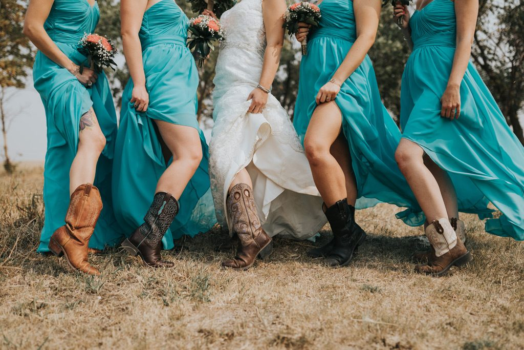 bridesmaids show off different cowboy boots