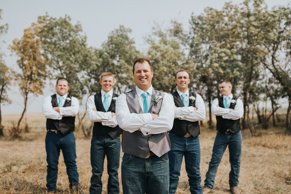 groomsmen smile for photo