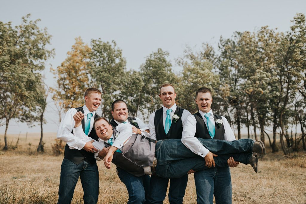 groomsmen pick up groom fail photo