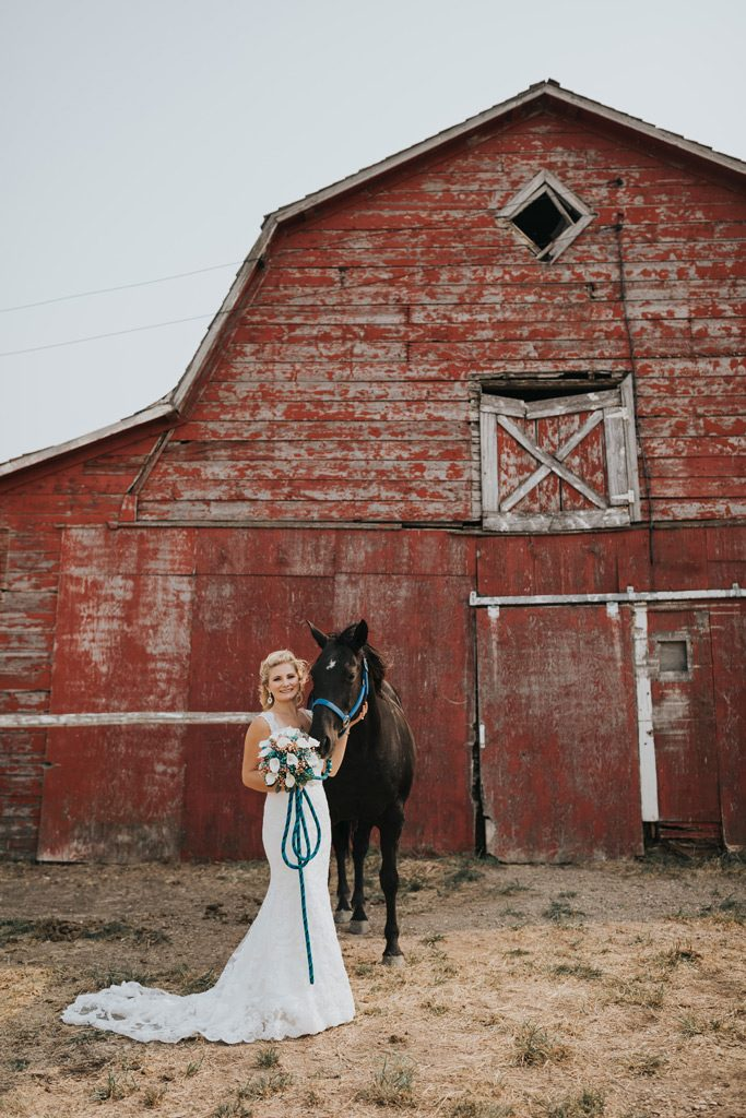 bride and stampede princess stands with her horse