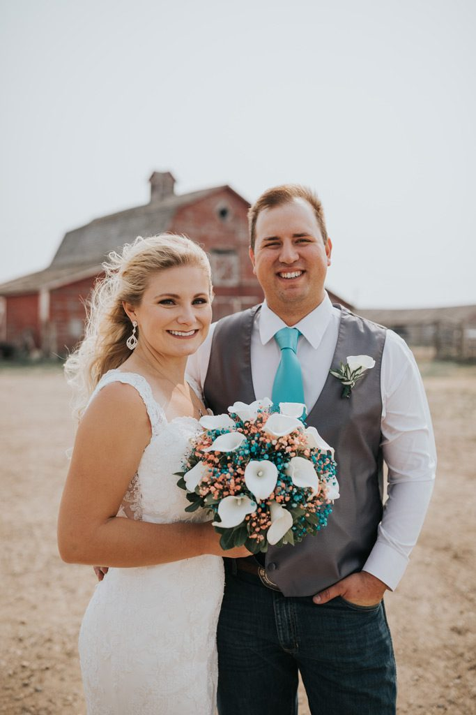 bride and groom smile happily family farm wedding