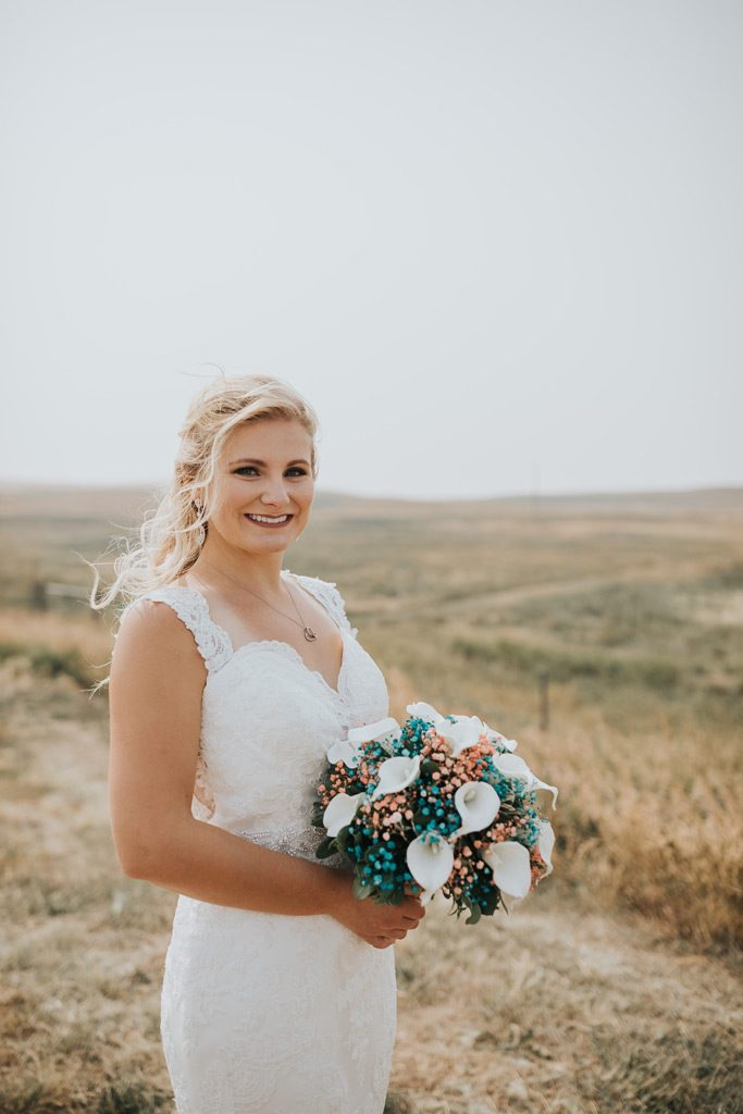 bride smiles with bouquet family farm