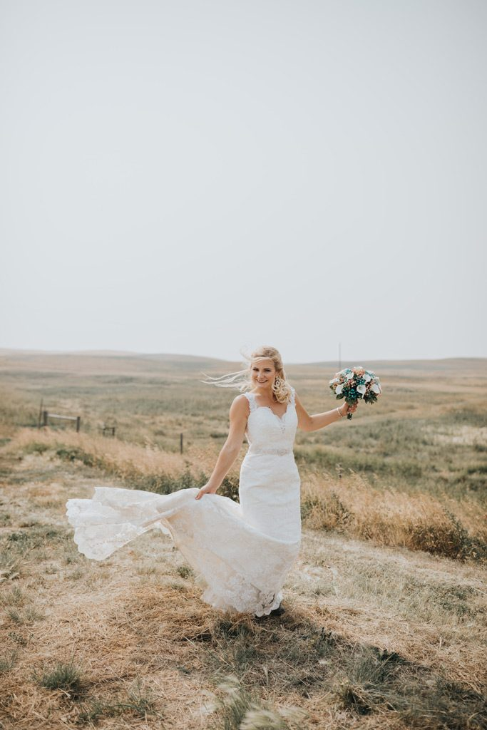 bride twirls her dress with long train