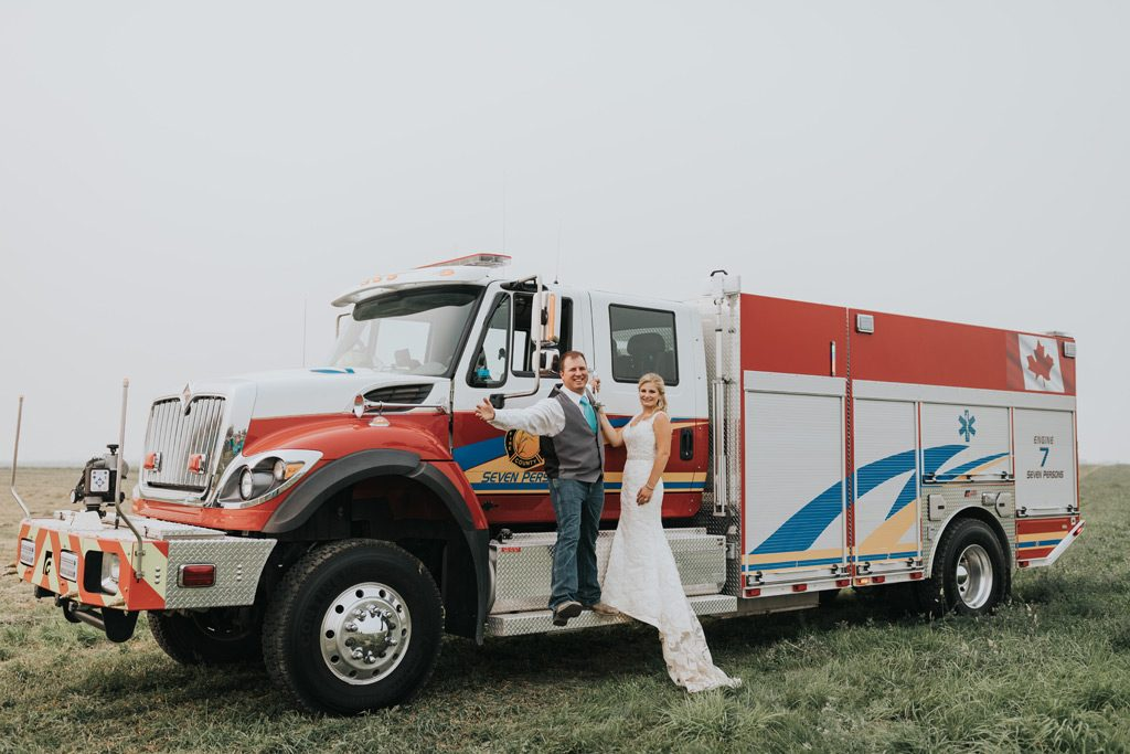 bride and groom hang onto fire truck seven persons