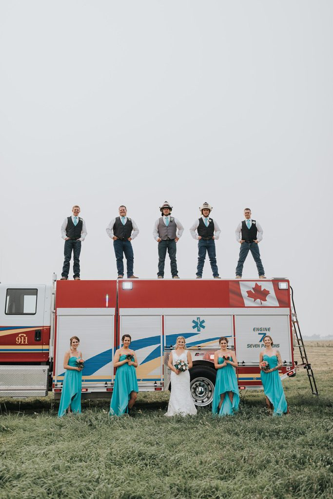 bridal party poses on fire truck