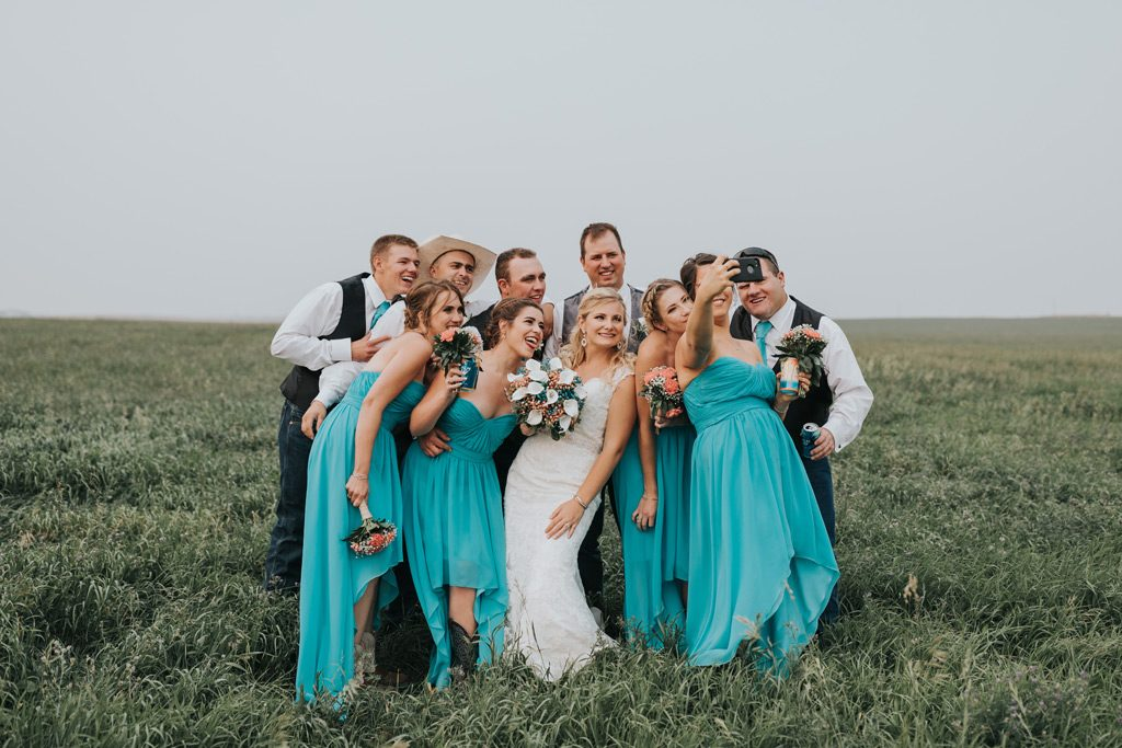 bridal party poses for selfie photo